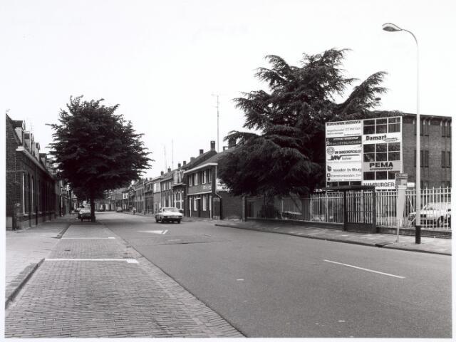 016651 - Broekhovenseweg in de richting van het centrum. Rechts bedrijvenpark Broekhoven, gevestigd op het terrein van de voormalige twernerij - ververij Broekhoven