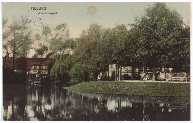 002881 - Wilhelminapark, rechts de muziekkiosk, links het bruggetje over de vijver.
