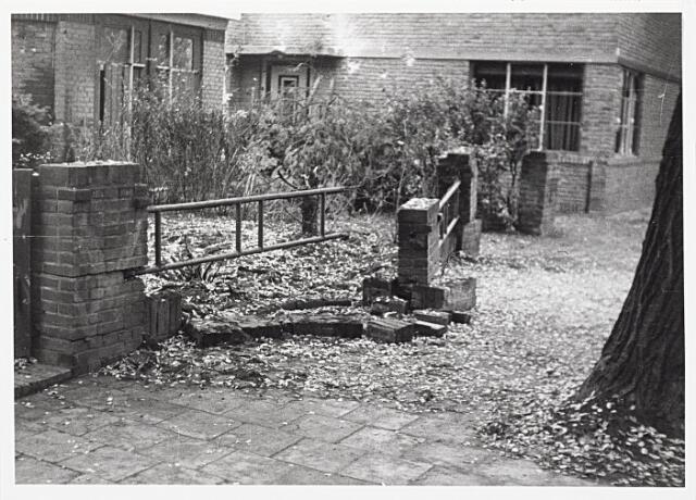 012396 - WO2 ; WOII ; Tweede Wereldoorlog. Vernielingen. Stille getuige van een luchtaanval in de Lovensestraat