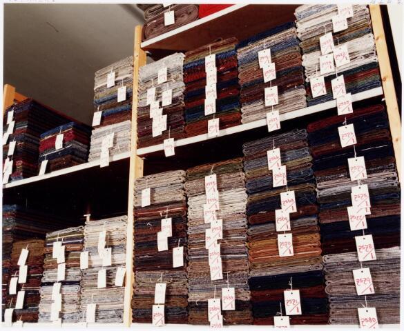 037977 - Textiel. Magazijn van wollenstoffenfabriek C. Mommers & Co. aan de Kraaivenstraat