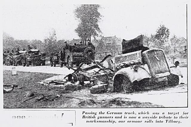 013238 - Tweede Wereldoorlog. Bevrijding.  Aan flarden geschoten Duitse legertruck langs de weg tussen Tilburg en Hilvarenbeek. Deze foto stond op maandag 30 oktober 1944 afgedrukt in de Britse krant The Daily Sketch