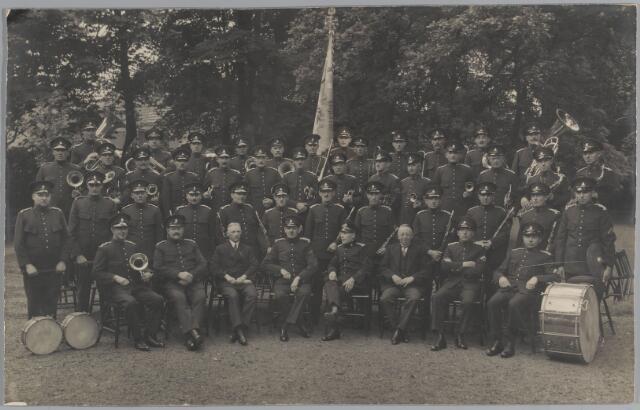 068451 - Tilburgs Politie Muziek Corps, opgericht op 21 september 1927. Directeur H.J.F. van Abeelen. Zittend van links naar rechts: F. van Haperen, H.W. Smulders, P.A.M. Preusting, Th. Raaphorst, H.J.F. van Abeelen, G.W.A. van Koredelaer, B.H. te Marvelde en J. Wannet. Tweede rij van links naar rechts: J.N. van Gijzel, H.C. Massuger, J. Hofland, P.F.C. van Son, J.H. Lenting, J.P.Th. de Rooij, G.J.Th. te Kaath, P.J. Gerrits, J.J. Vrinssen, W. Fievez, P. Elzinga en A.B.E. Aubroeck. Derde rij van links naar rechts: J.H. Cremers, A.J.C.C. Jonai, C.H. Raes, P.J. Dubois, P. van Hoesel, H.E. Verijken, C.W. Nuijten, L.H.H. Peeters, E.H.J. Want, Frans Massuger, G.W. Steenveld, H. Stellinga, P.A. Leenards en P.H. Brinkman. Achterste rij van links naar rechts. J.W.L. Bindels, A.Th. Hippman, A. van der Ven, C. Hack, J. Heuvelmans, P. van Halteren, A. de Groot, W.F. Corsten, P.H. Eerden, F.B.J. te Kaath, G.D. van de Meeberg en H. Donselaar