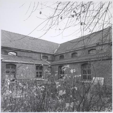 025293 - Achterzijde van het voormalige St. Rochusgesticht aan de Lange Nieuwstraat in december 1979
