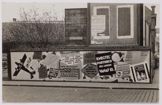043955 - Reclamewand op den hoek Heuvel-Tuinstraat.