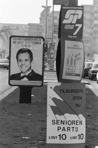 TLB023002723_003 - Politiek. Verkiezingsposters op middenberm voor gemeenteraadsverkiezingen in Tilburg op 21 maart. Met Jos Brink op affiche.