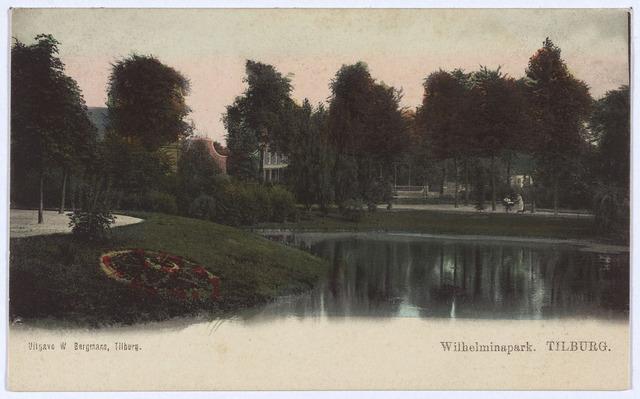 002910 - Vijver in het Wilhelminapark met links aan de oever een Victoriaans bloemperk.
