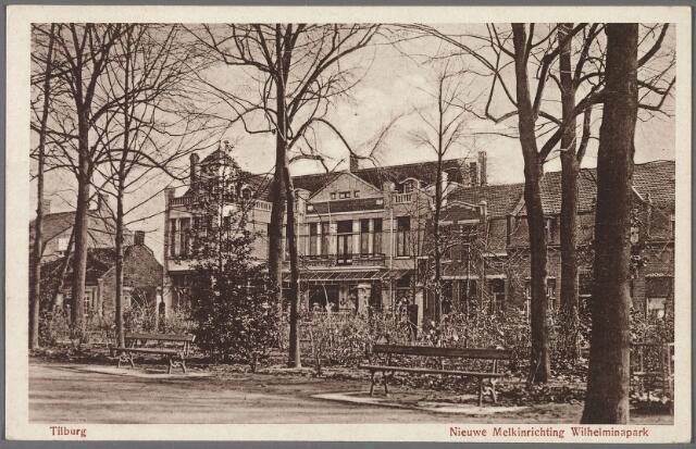 010266 - Zuidoostzijde van het Wilhelminapark met in het midden de Coöperatieve Tilburgsche Melkinrichting en Zuivelfabriek (C.T.M.). De naam veranderde in 1972 na een fusie met melkfabriek St. Jan te 's-Hertogenbosch in Coöperatieve Zuivelvereniging Centraal Brabant. Later volgde nog een fusie en naamsverandering in DMV Campina BV. Inmiddels was door fusering het aantal melkfabrieken in Brabant teruggebracht tot 15 produktiebedrijven, waaronder een kaasfabriek aan de Jules Verneweg in Tilburg. Eerder was deze kaasproduktie ondergebracht in de voormalige coöperatieve zuivelfabriek St. Adrianus aan de Bloemenstraat in Hilvarenbeek. Op het bedrijf aan het Wilhelminapark werd op 26 april 1980 de laatste, in een kan aangevoerde melk in ontvangst genomen door oud directeur R. Bouwman. Een jaar later, in januari 1981, werd de fabriek onder directeur J. van der Steen gesloten. In 1982 werd het pand bij besluit van B. & W. op de gemeentelijke monumentenlijst geplaatst.