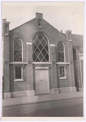 025084 - Voormalige kapel aan de Lange Nieuwstraat, later in gebruik bij turnvereniging Olympia. Ook was er behang- en verfwinkel Pébé in gevestigd. Is inmiddels gesloopt ten behoeve van nieuwbouw