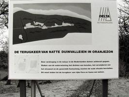 Bord over beheer van het waterwingebied Oranjezon door Delta Nutsbedrijven.