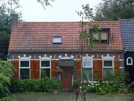 Koekoek 7 (voorheen een café), tussen Driewegen en Ellewoutsdijk