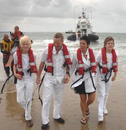 zeven stellen maken van de mogelijkheid gebruik om tijdens Rescue op het strand …