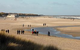 wandelelaars op het strand